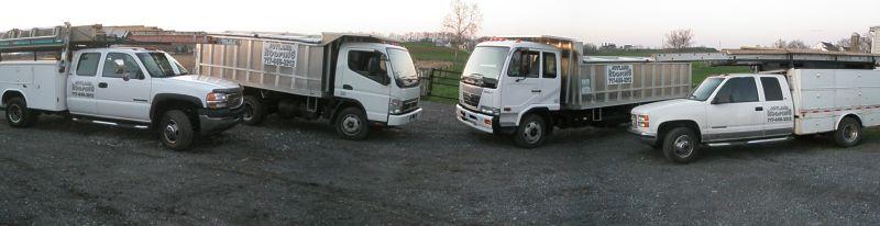 4 white Joyland Roofing trucks on road