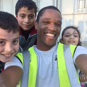 man and 3 kids posing for a selfie