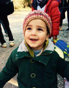 little girl smiling at sky