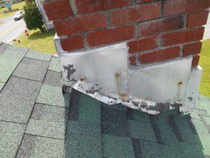 metal flashing around base of chimney of roof