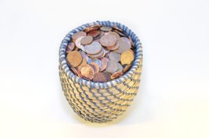 coins in a small woven basket