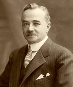 Milton Hershey in a suit looking at camera