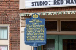 blue sign designating Fulton Opera House a landmark