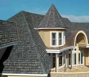 two story house with copper roofing