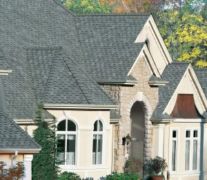 two-story house with gray slate asphalt shingles on the roof