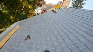 side view of a roof with manufactured slate roofing