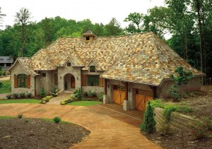 House with premium asphalt shingles surrounded by trees