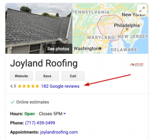 screenshot of Joyland Roofing Google My Business profile with an arrow pointing to the reviews section