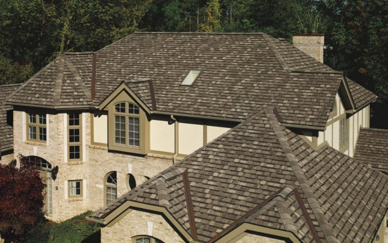 2 story house with brown professional roofing installed