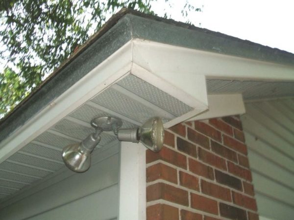 corner of the roof of a house with soffit ventilation installed