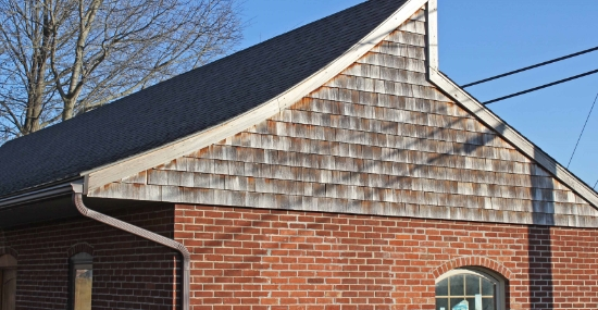roofing on red brick building