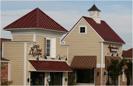 tan business building with red roofing
