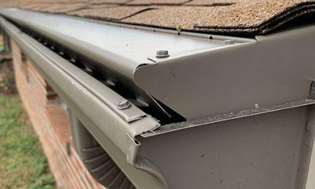 metal gutter guard on a brick house