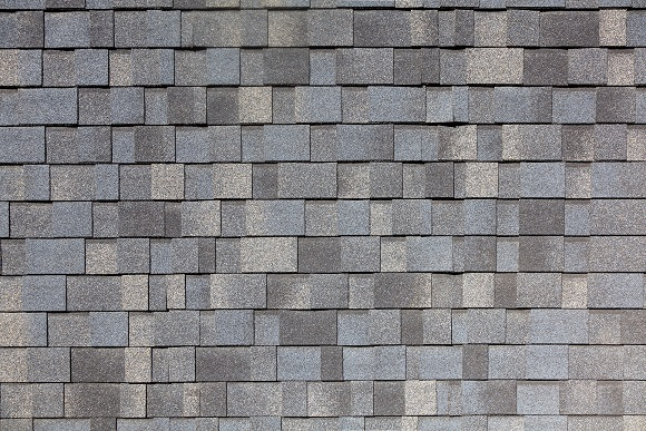 asphalt shingles laid out next to each other in rows