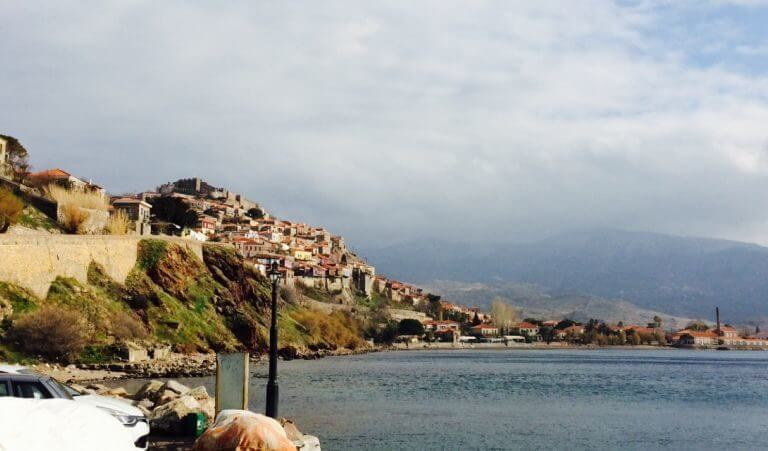 mountains with houses next to the Mediterranean sea
